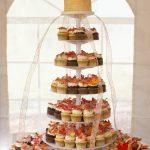 Wedding cake and cupcakes tier